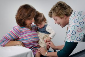 Child receiving an intramuscular injection from a Family nurse practitioner.