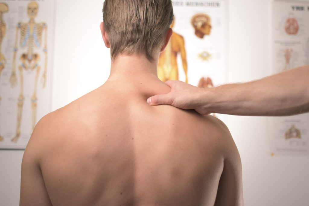 Doctor treating neck and shoulder pain