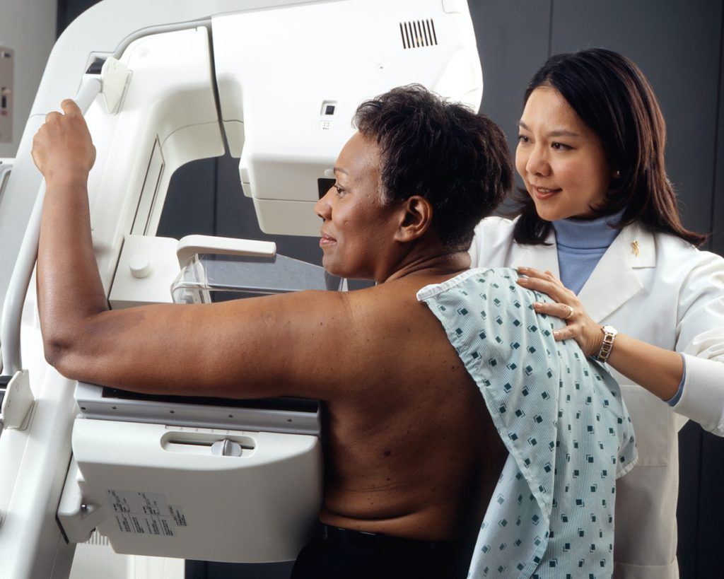 Woman receives mammogram with a certified technician. Available at Humber Diagnostics Center